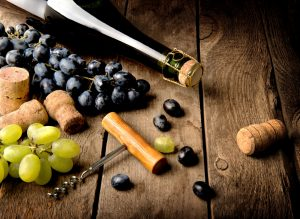 Grape and wine on a wooden table